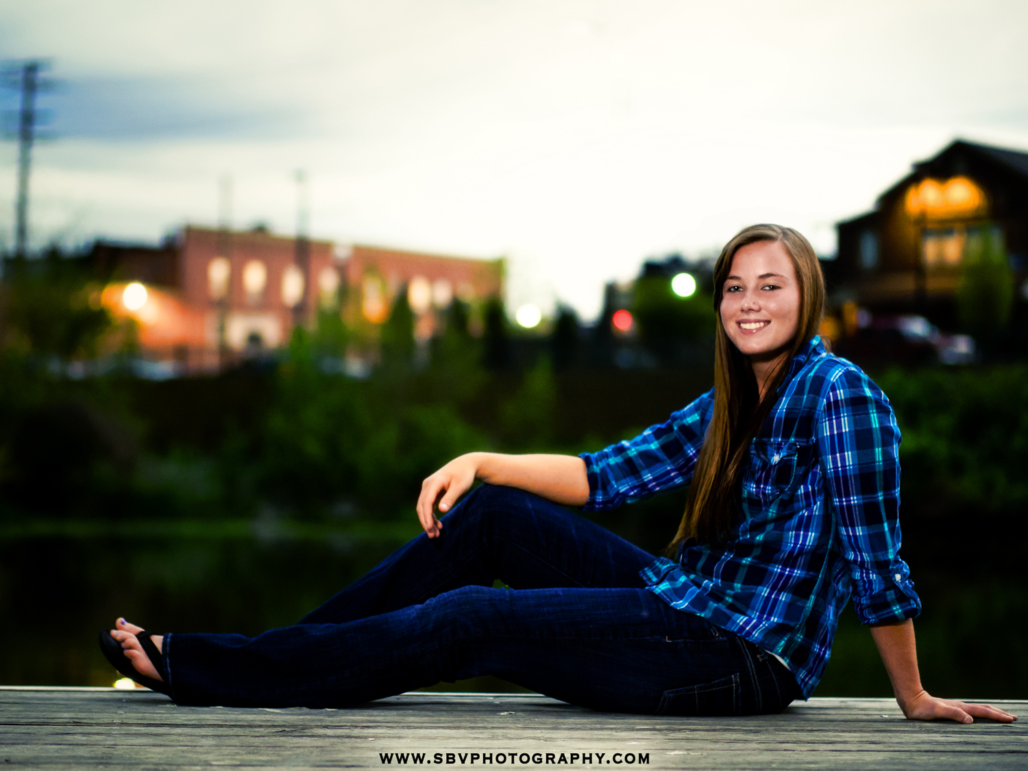 High school senior photo at the edge of the pier at the Hobart, Indiana lakefront.
