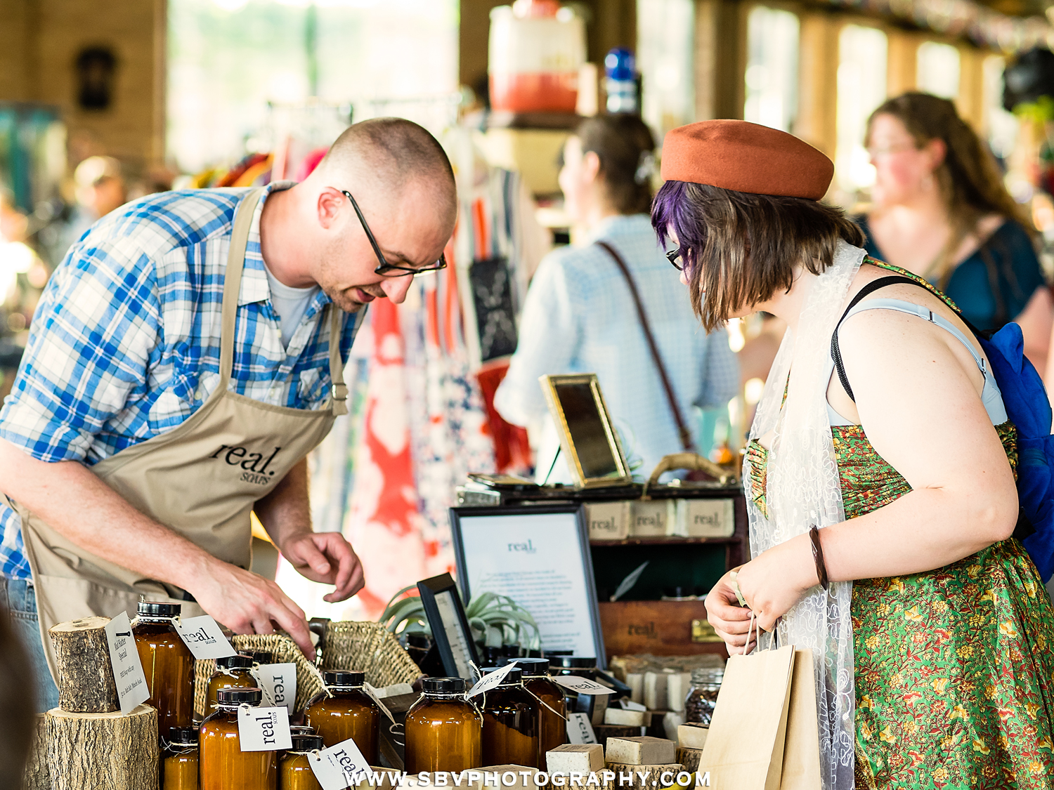 A shopper purchases Real Soap at the Hunt and Gather pop up market.