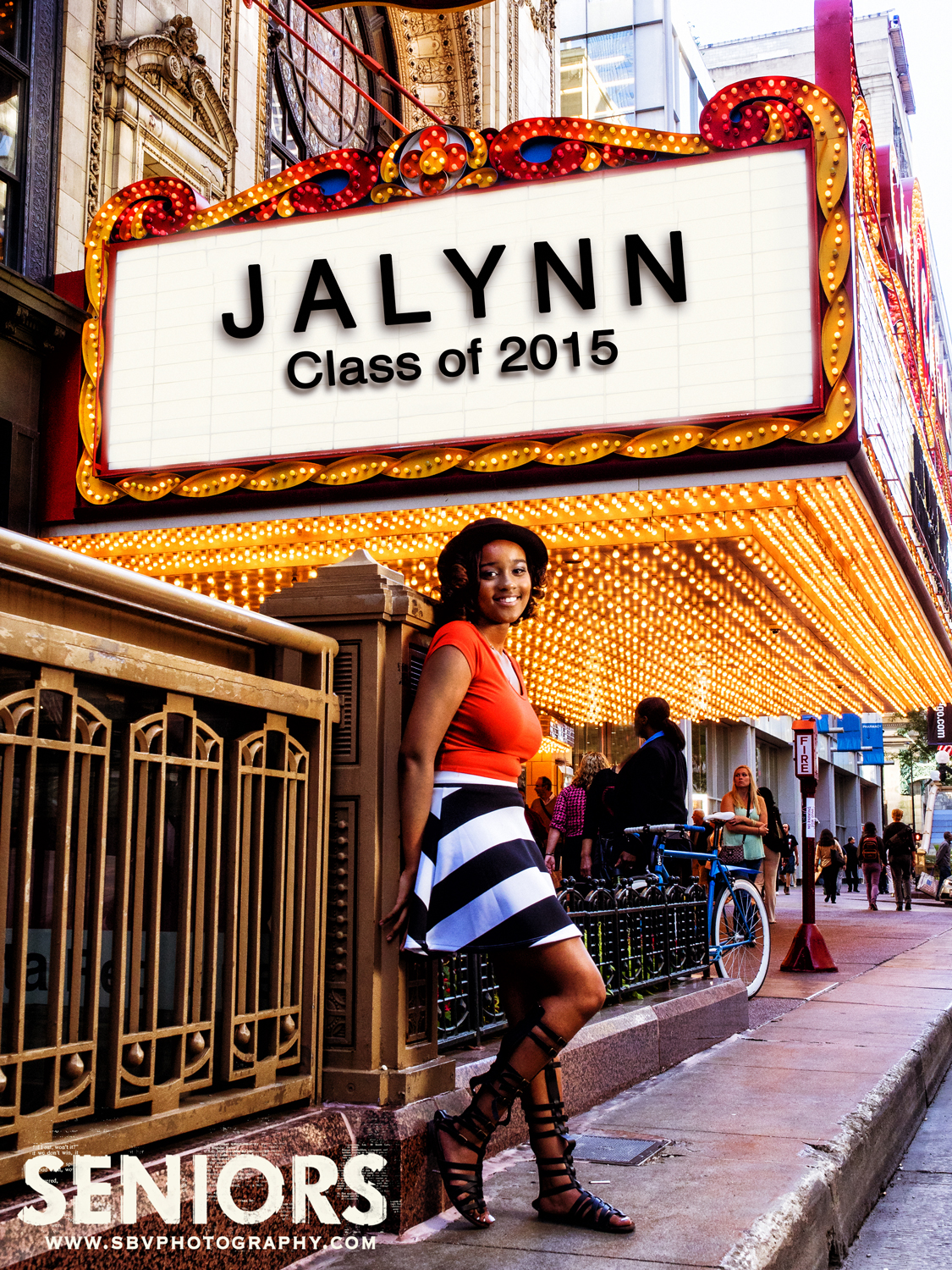 A high school senior poses in front of the landmark Chicago Theater on State Street.