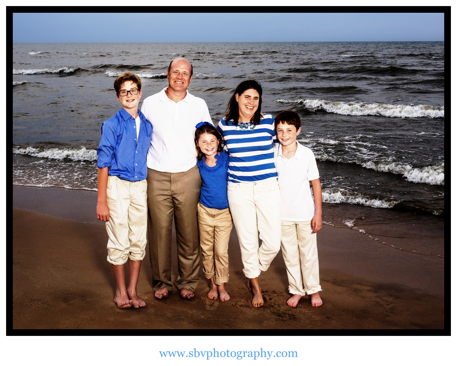 A family photo taken at Marquette Park Beach with Lake Michigan in the background.