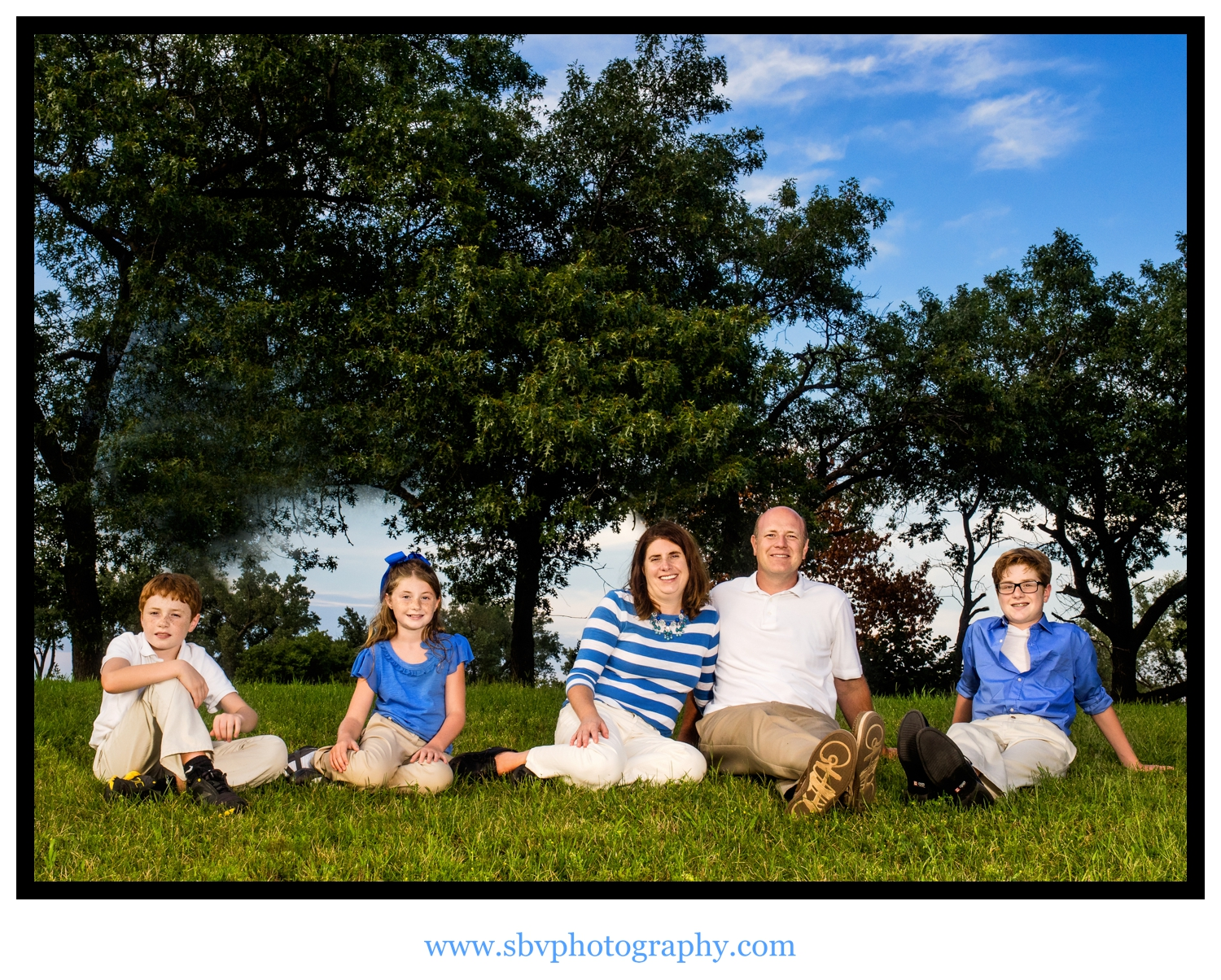 Family portrait on a scenic hill at Marquette Park.