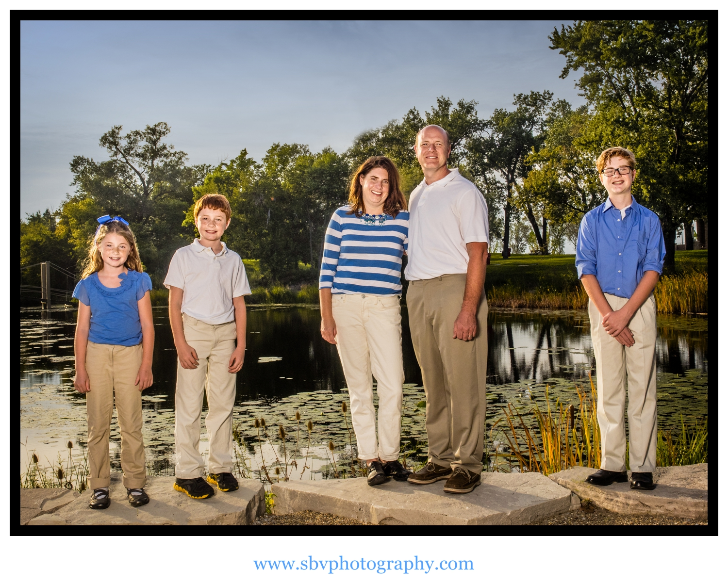 A family photo overlooking the lagoon at Marquette Park Pavilion.