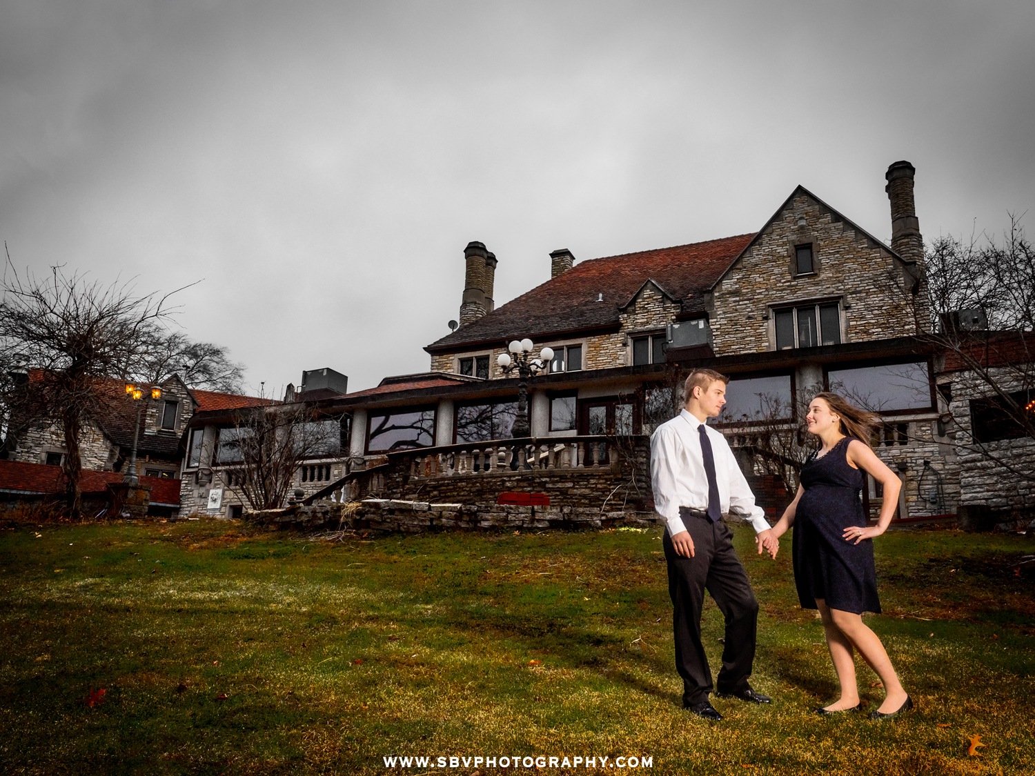 A husband and wife celebrate their pregnancy with portraits at Meyer's Castle in Dyer, Indiana.