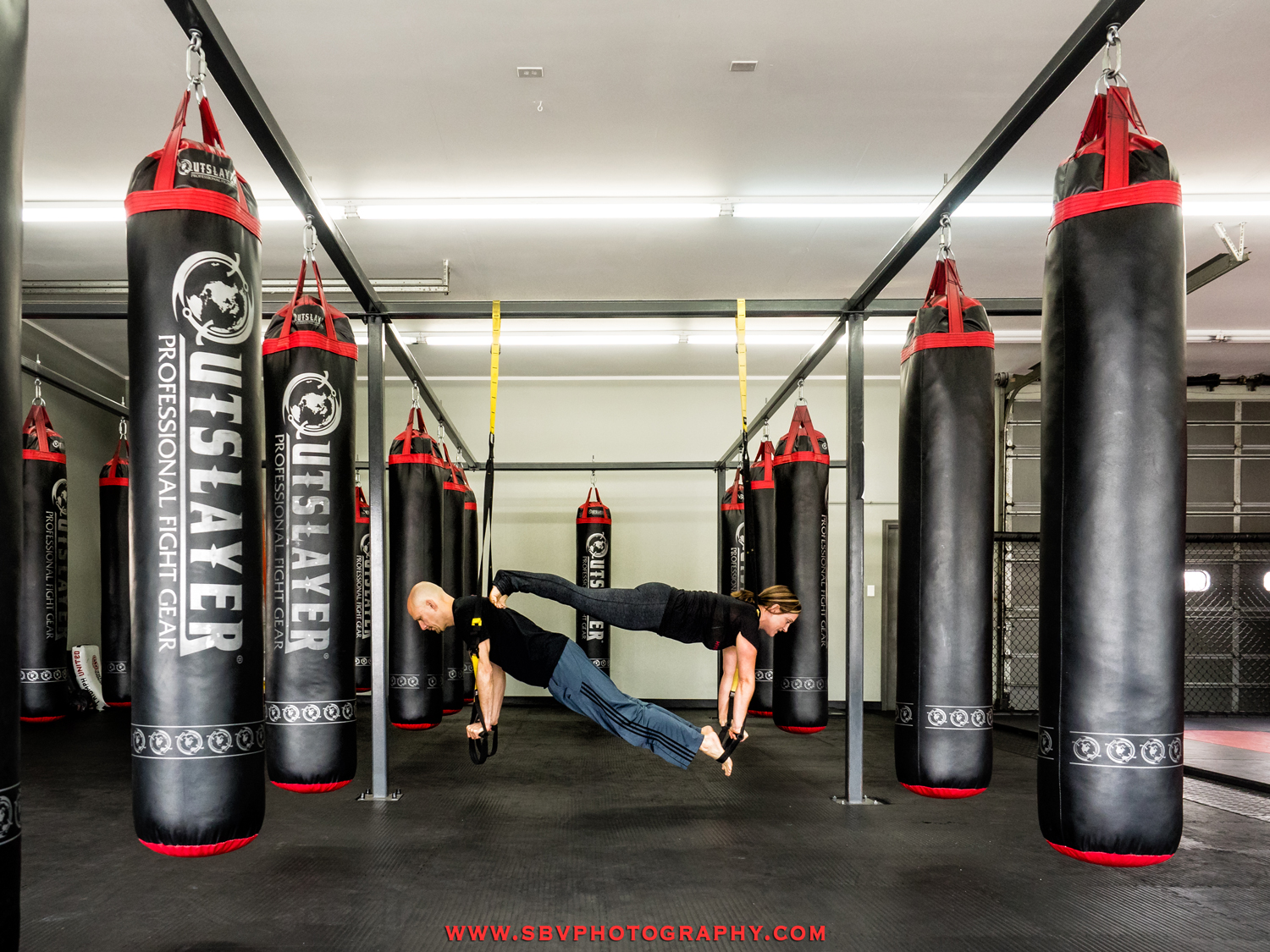 The fight bags at Hybrid Athletics.