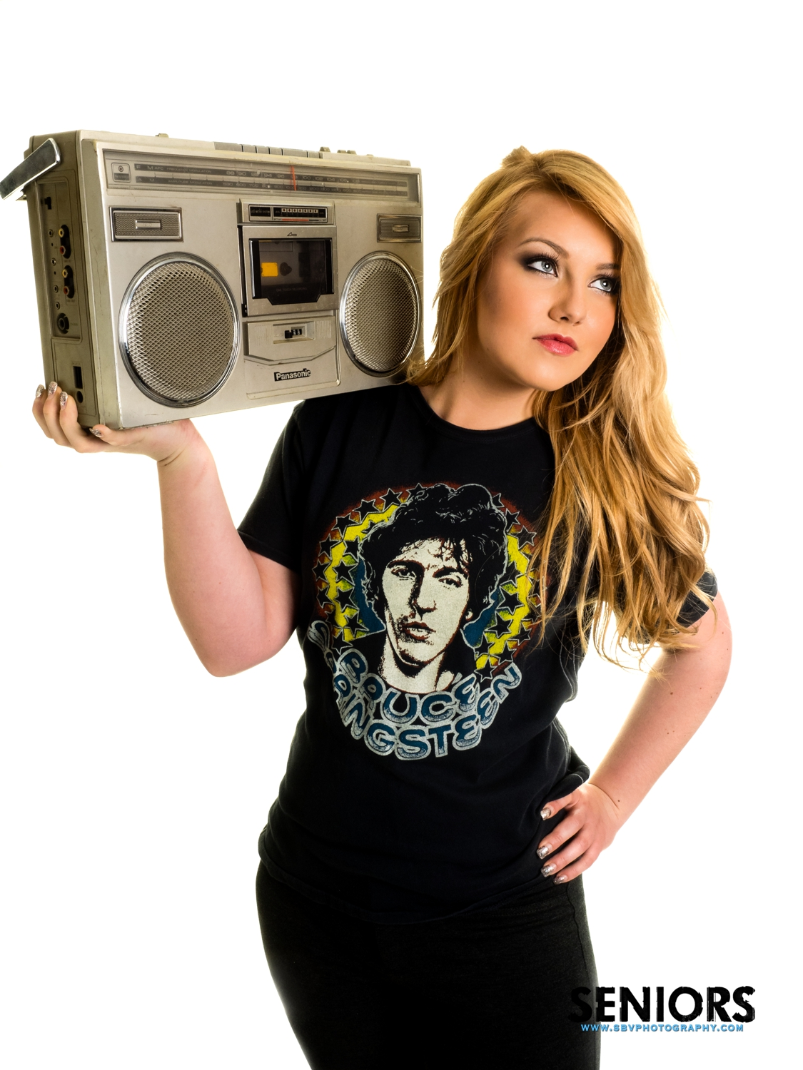 A retro boom box and Bruce Springsteen tour shirt is featured in this music themed senior picture session.