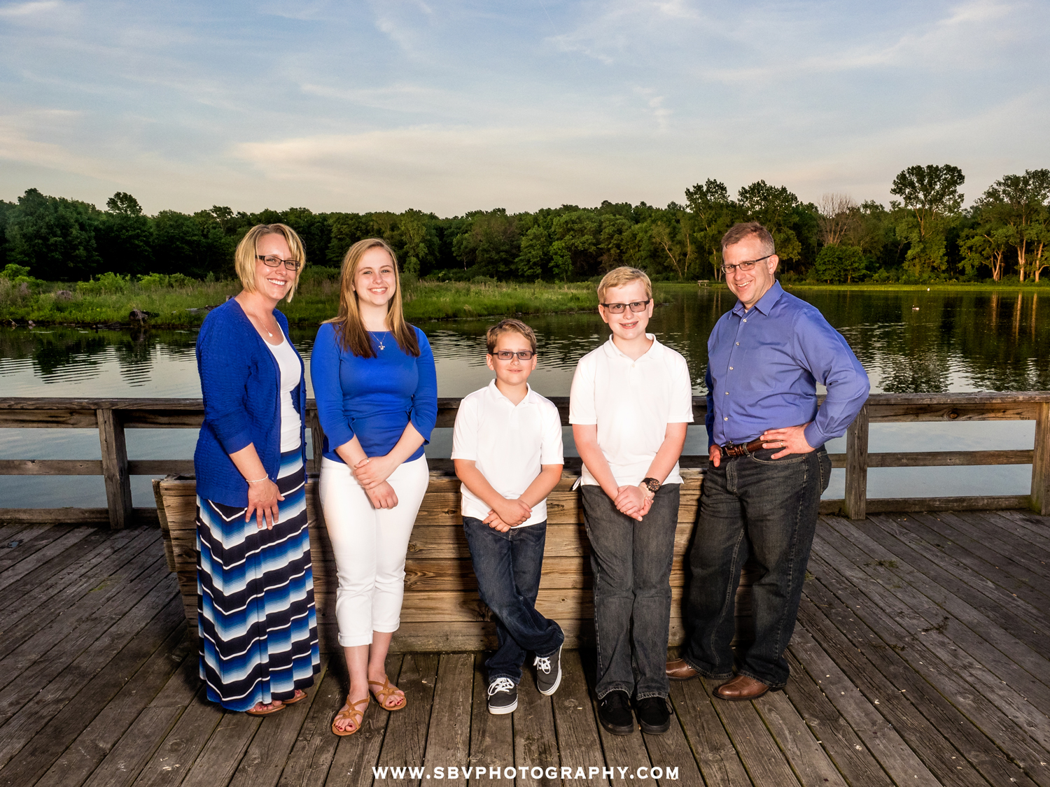 Family photos on the pier overlooking the lake at Oak Ridge Prairie.