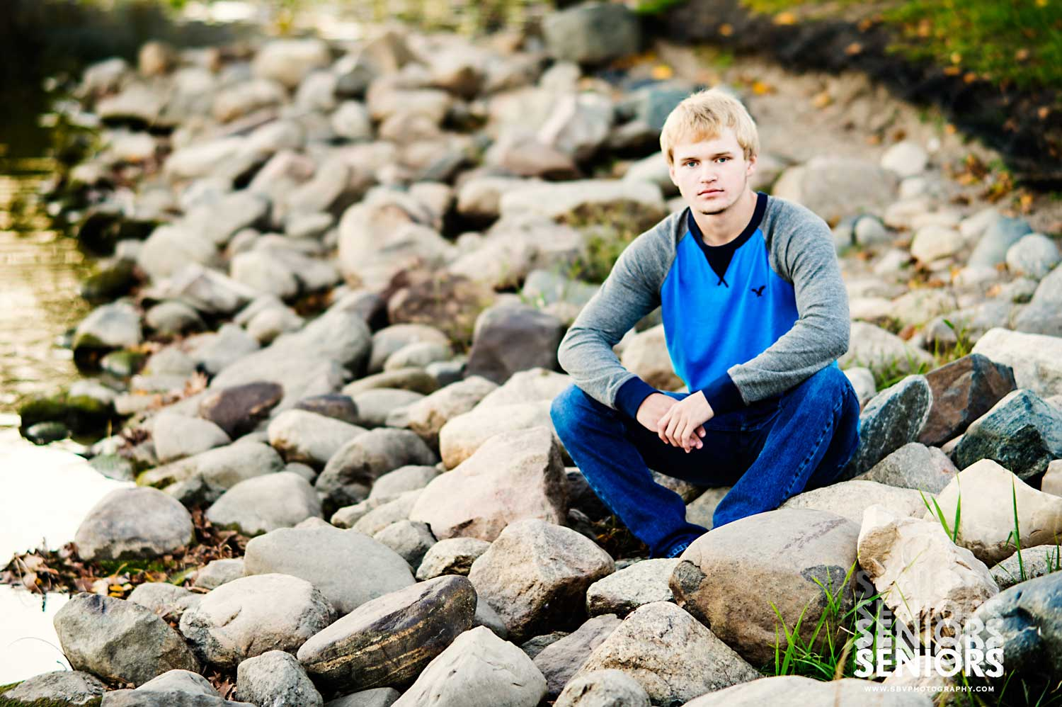 A high school senior relaxes on the rocks along Lake George in Hobart, Indiana.