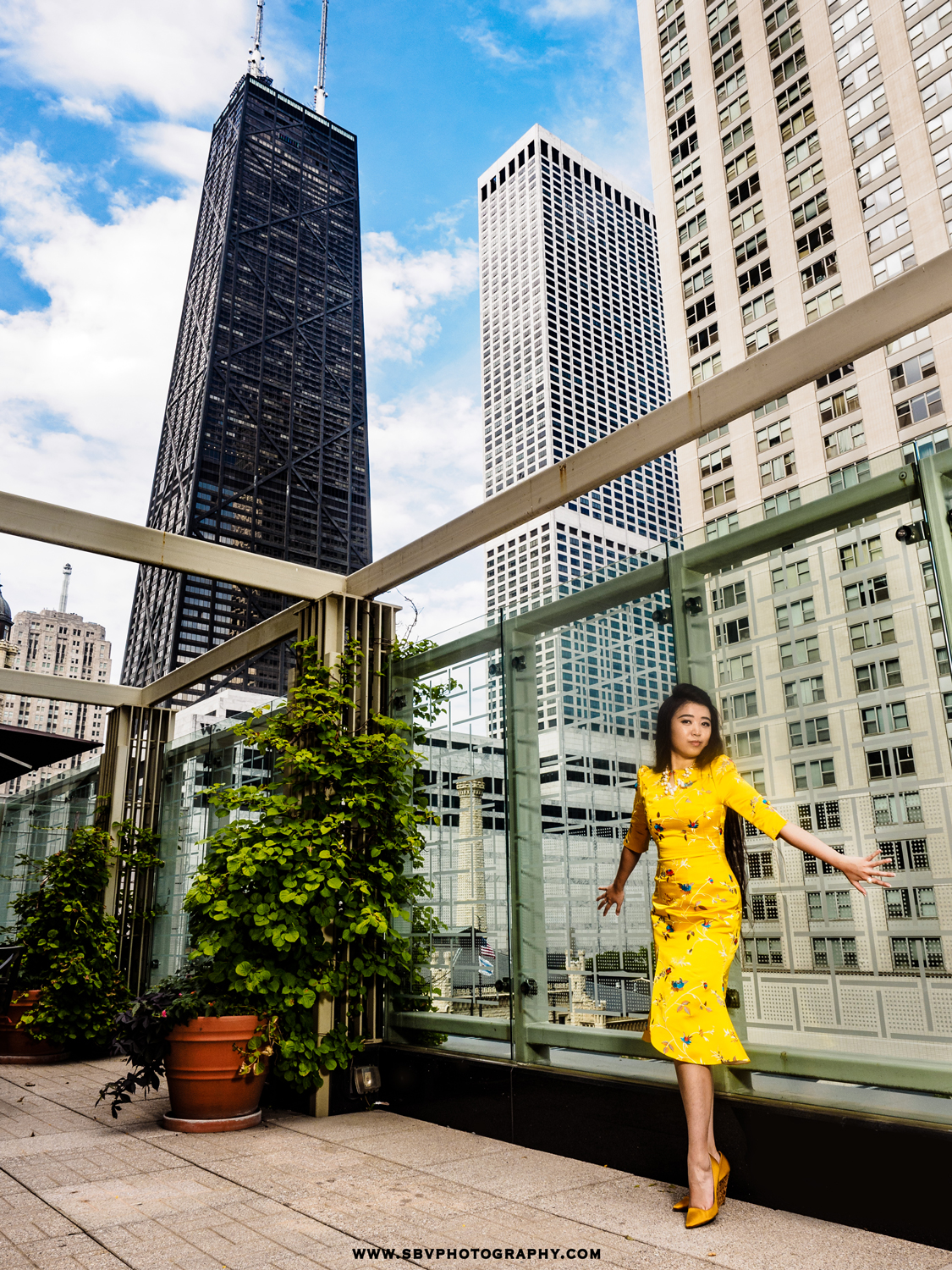Portrait overlooking the city of Chicago from the terrace of The Peninsula Hotel.
