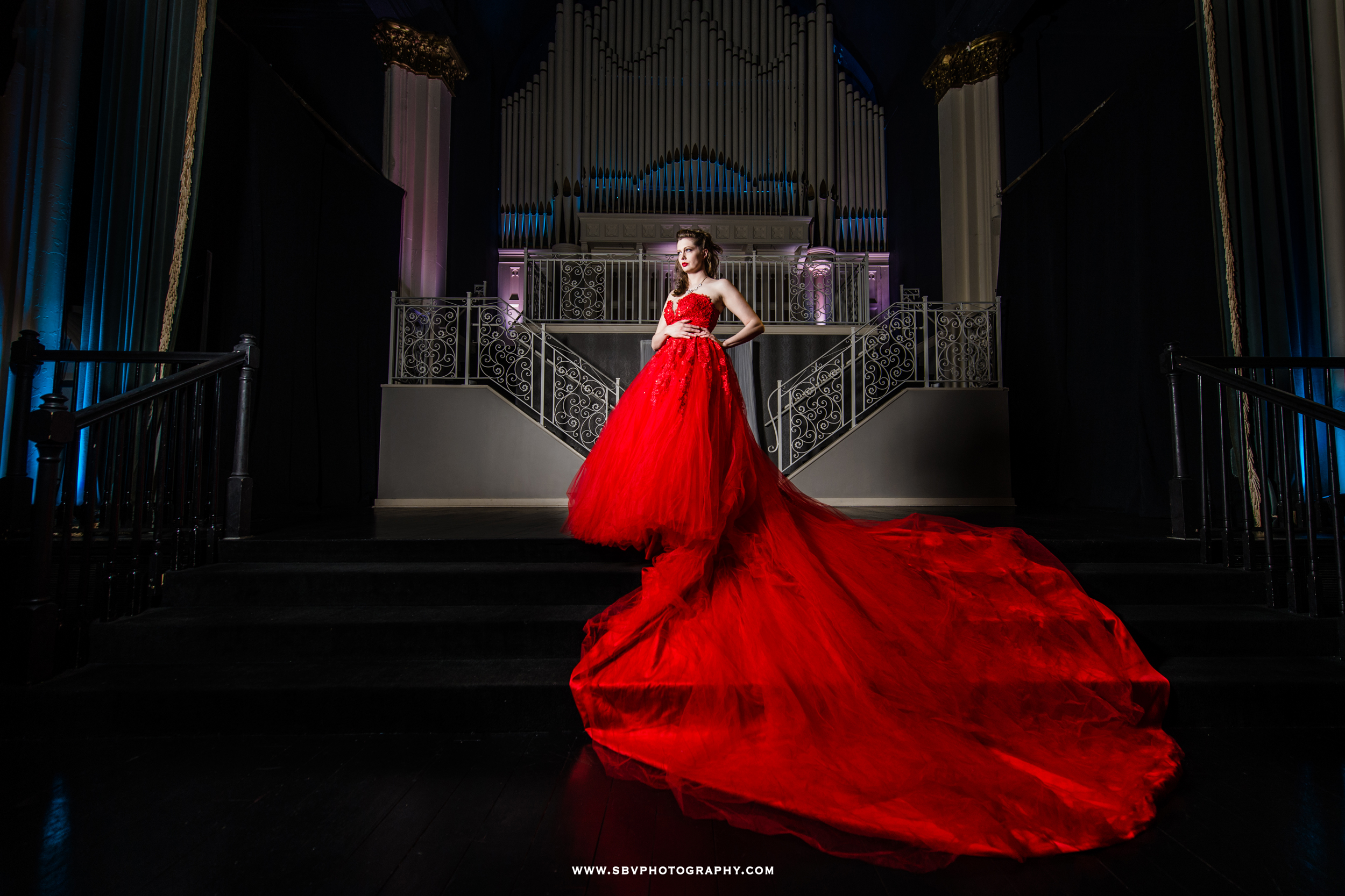 The Scarlett Obsession Gown with it's long train on the ballroom stage.