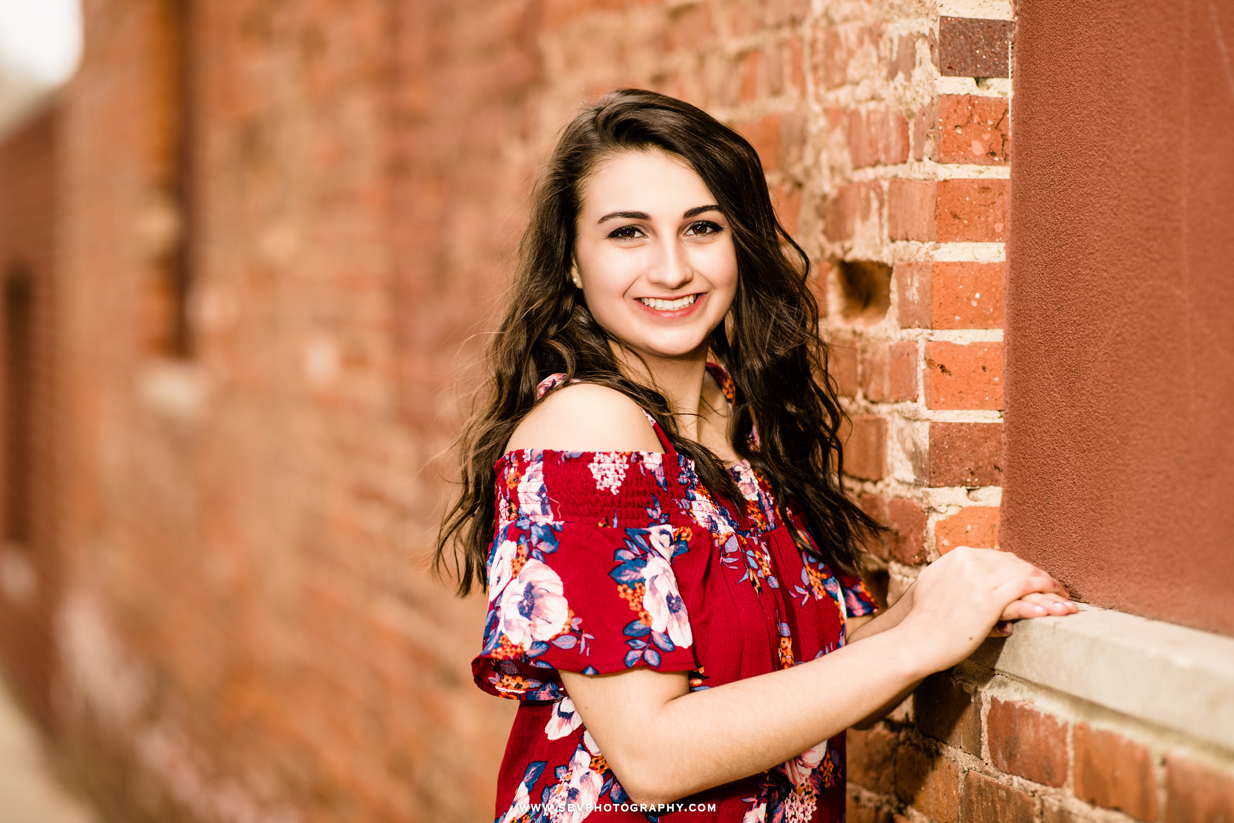 senior-girl-brick-wall.jpg