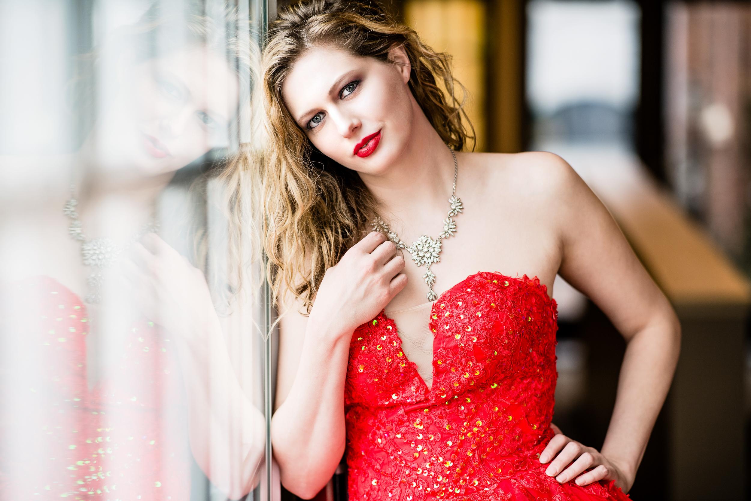 woman-red-dress-window-reflection.jpg