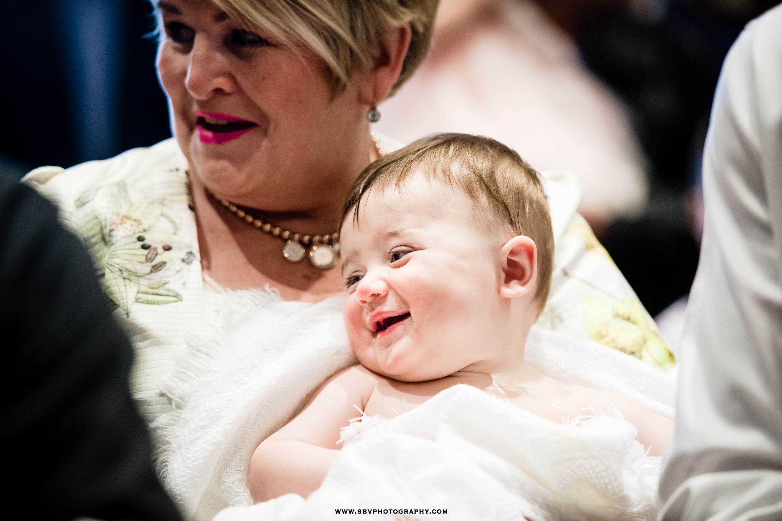 Happy baby during his baptismal ceremony.
