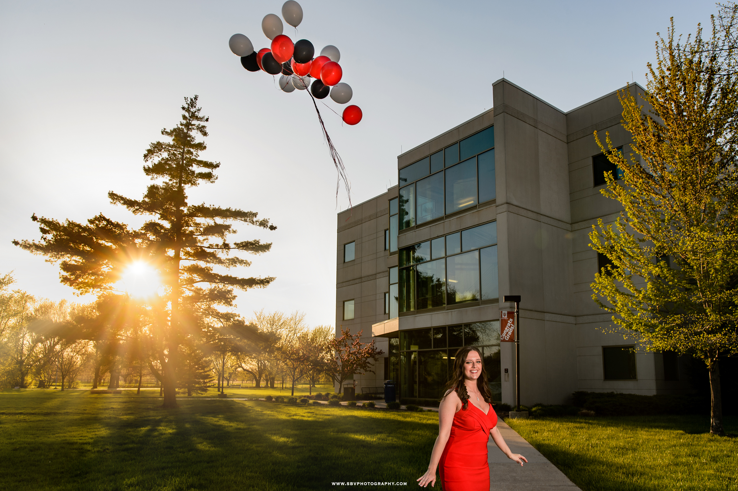 Balloons are released in celebration by an Indiana University graduate.
