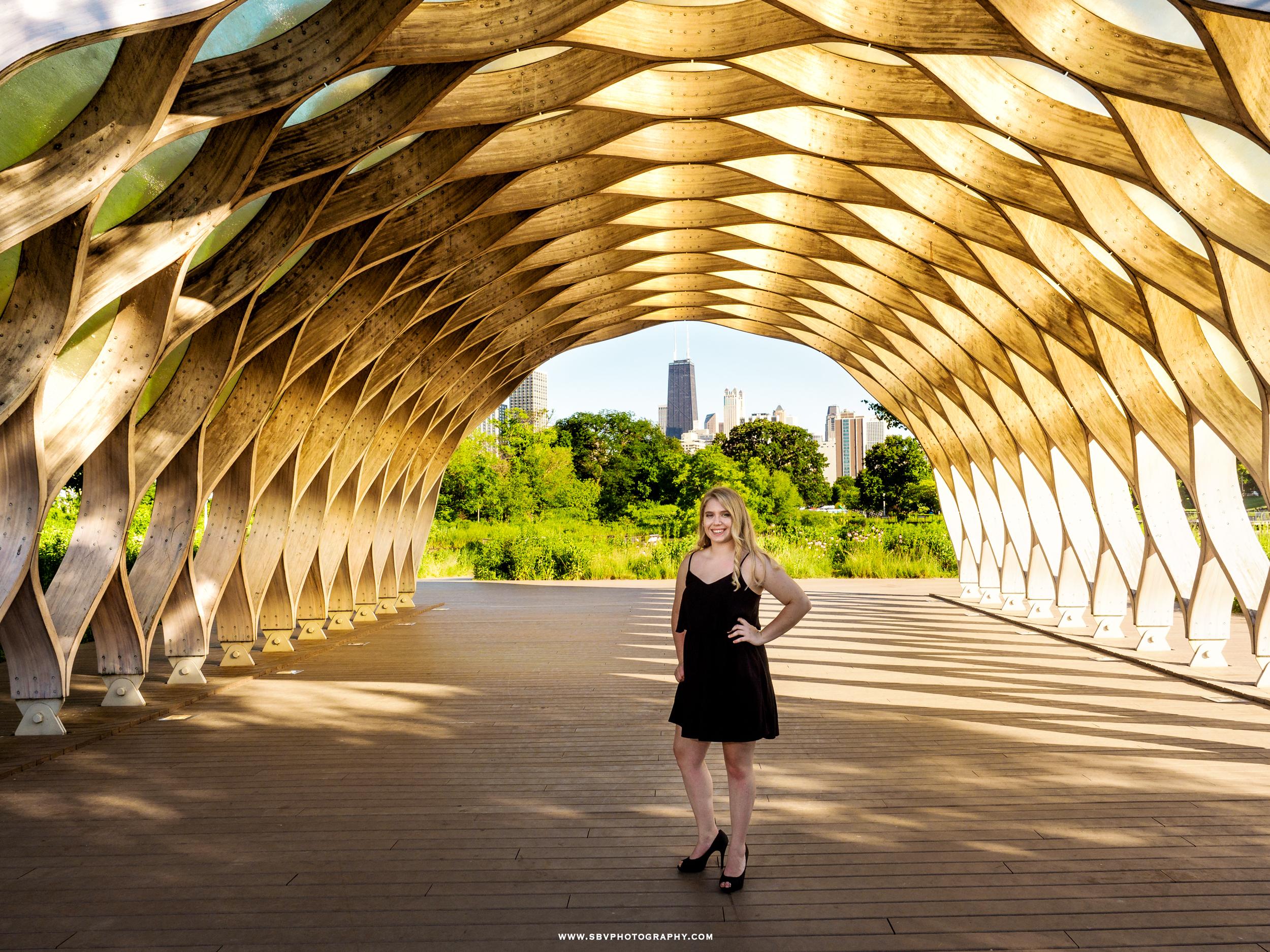 Senior girl underneath the honeycomb structure in Chicago.