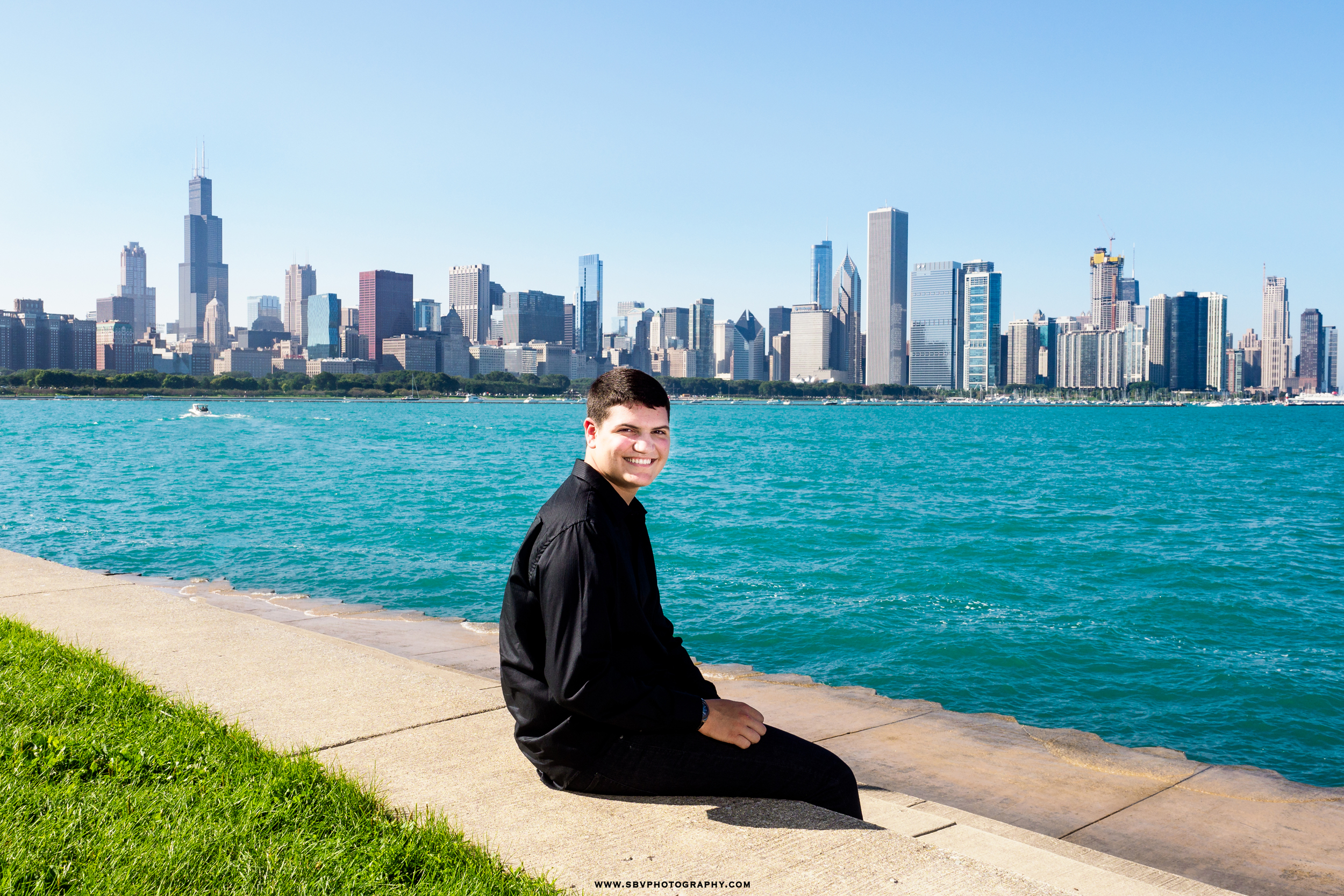 High school senior picture on the shore of Lake Michigan.