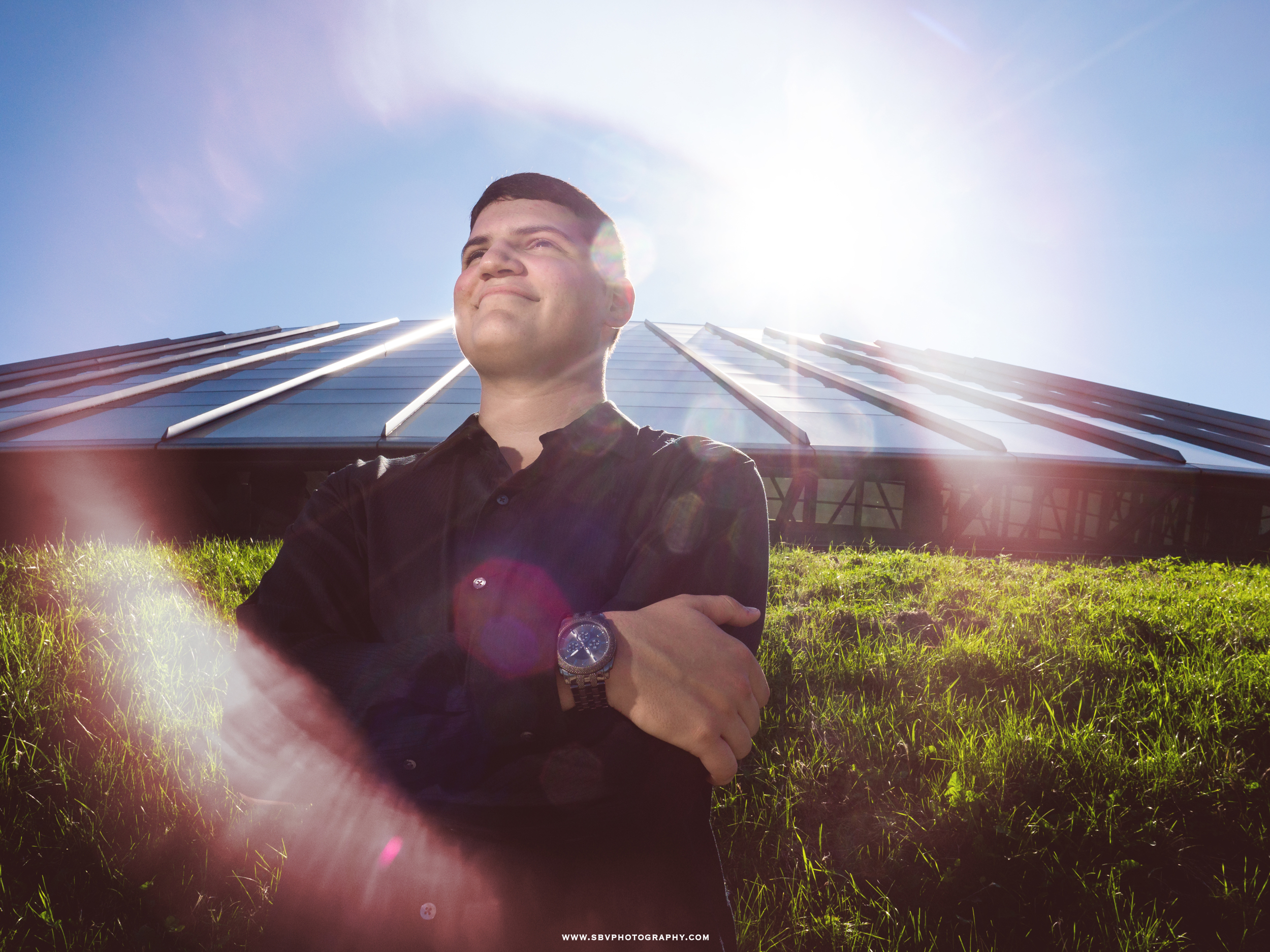 A ring of sun flare illuminates a high school senior in Chicago.