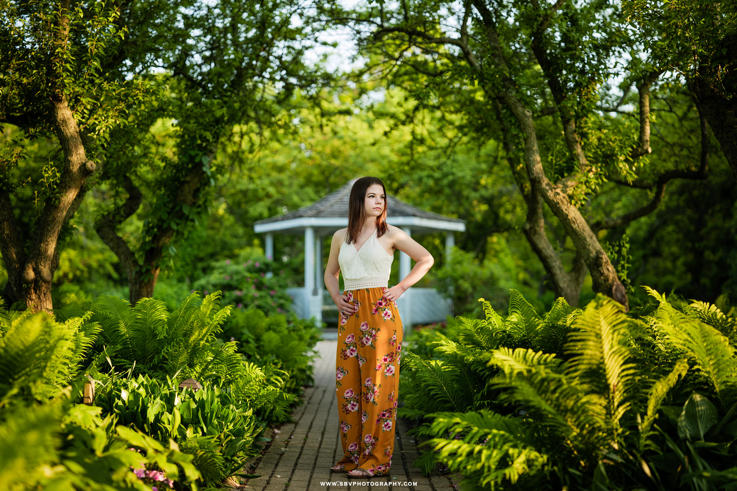 Senior girl at Ogden Garden gazebo walkway.