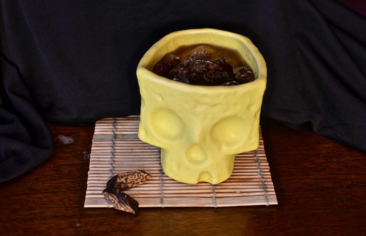 Bombo in a Vantiki skull sippy cup.