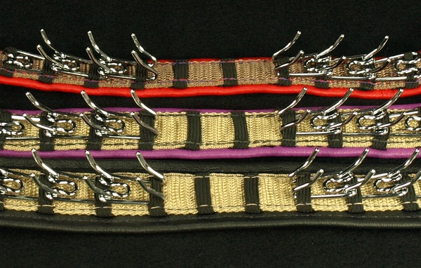 Here are our three sample collars, all with single leather lining and   medium prongs  . This photo shows the underside of the collars. They are, from top to bottom, 3/4 inch (red), 1 inch (purple) 1 1/2 inch (Black)  Please remember the size of the collars are based on the web only, that is not the width of the over all collar after leather , the leather will add to the width and that my very on the leather you choose.