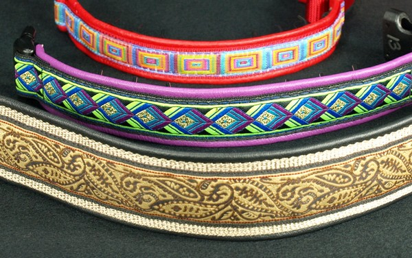 These are the same three collars showing more of how they would look when on the dog. In most circumstances, you cannot see the prongs on the 1 1/2 inch collar at all. The prongs are slightly visible on the (purple) 1 inch leather lined collar and more so on the (red) 3/4 inch leather lined collar. (The prongs are a little difficult to see in this photo because of the way the light is reflecting on them so look carefully.)