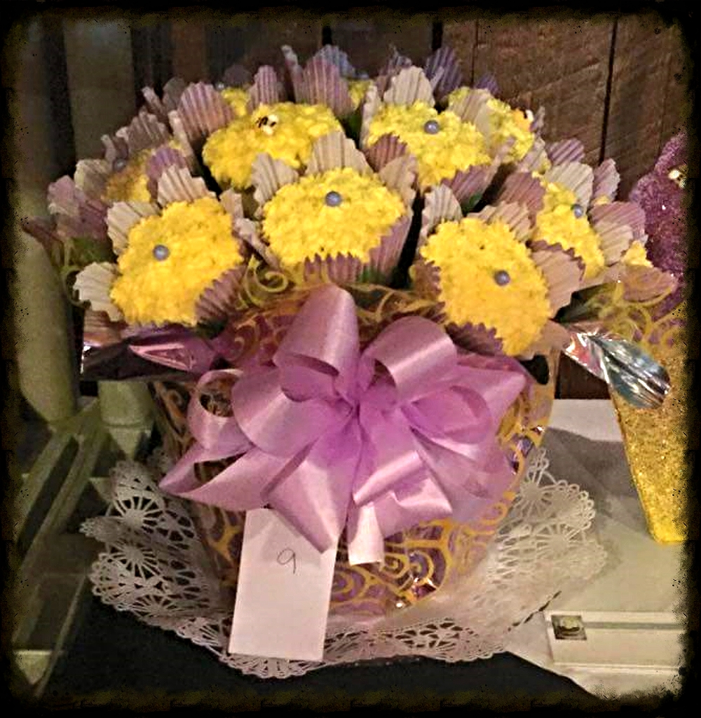 Kim won FAN FAVORITE at the Wooden Nickel cupcake wars in Silverton, OR with her colorful, tasty, and tempting lavender and yellow cupcake bouquet using The Cupcake Rack! Thank you Kim for sharing your beautiful display. It's almost as lovely as YOU! (Kim is an amazing woman!)