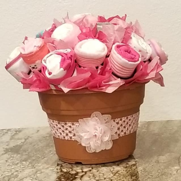 Diaper/Onesie Bouquet - Be the hit of the next Baby Shower when you bring this adorable Diaper, Onesie, Sockie, and Washcloth Bouquet using The Cupcake Rack. It's super fun and easy to make and your new momma will LOVE it!