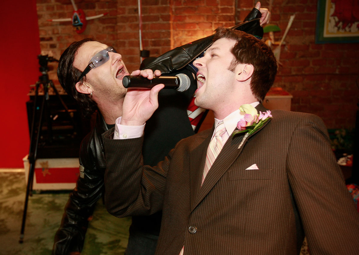 "Groom sings with ""Danno"" of the U2 tribute band ""Elevation"" at the Catalyst Ranch Chicago."