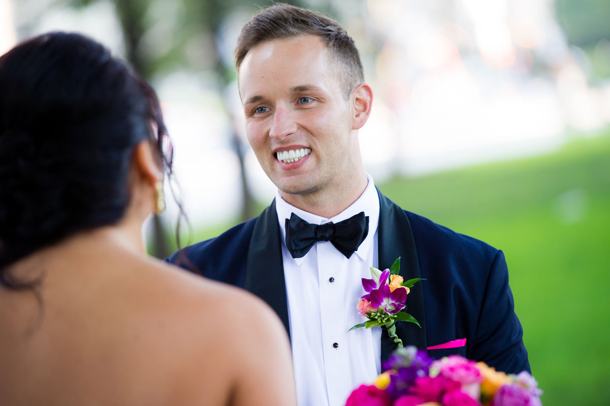 Groom sees his bride for the first time on their wedding day at Grant Park.