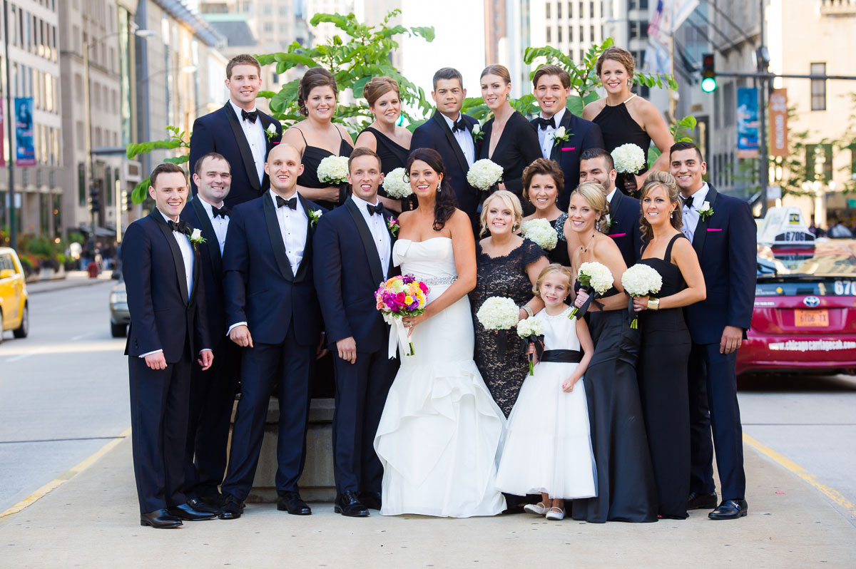 Bridal party photo on median of Michigan Avenue near the Wrigley Building.