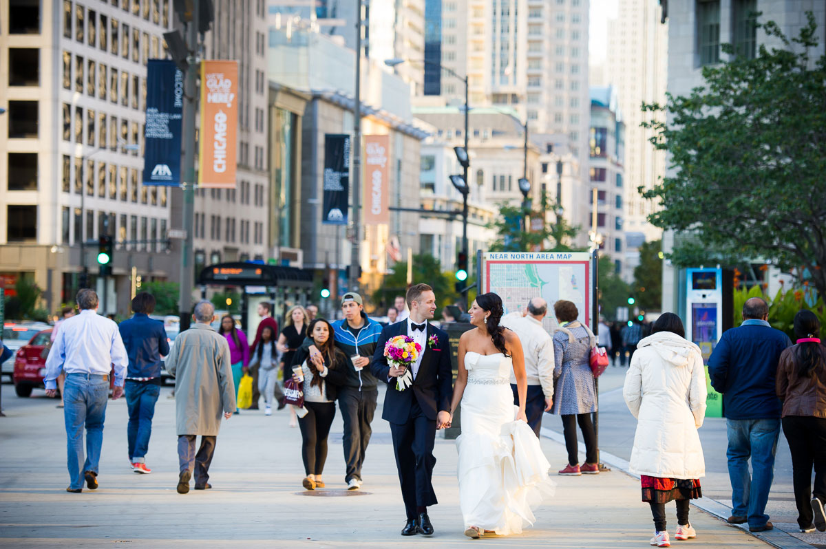 Couple strolls down Michigan Avenue on their wedding day.