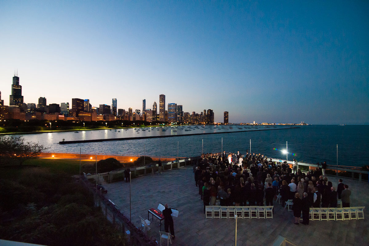 Sunset wedding ceremony at the Shedd Aquarium Chicago.