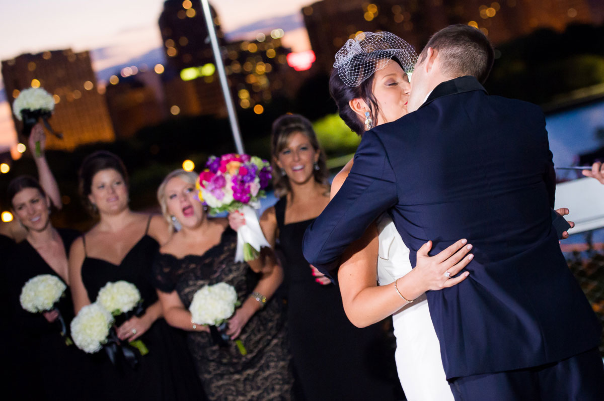 Couple's first kiss as husband & wife at the Shedd Aquarium Chicago.