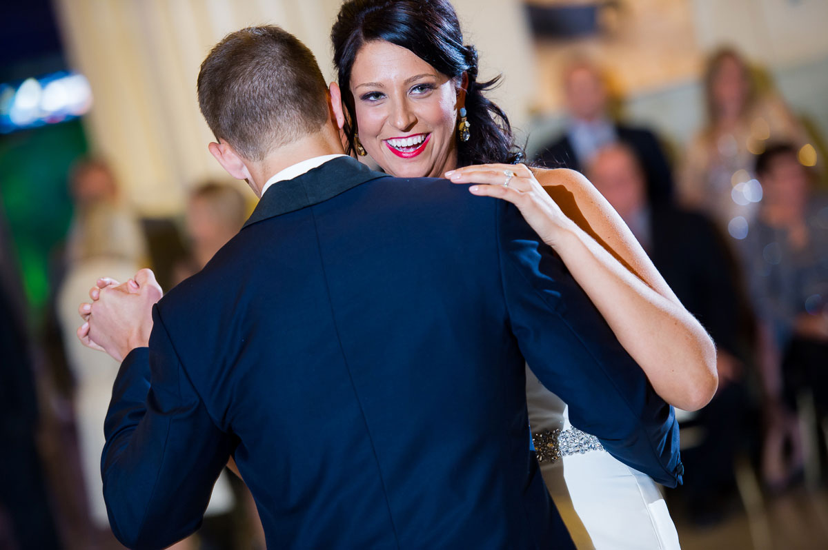 Brides smiles during the first dance at the Shedd Aquarium.