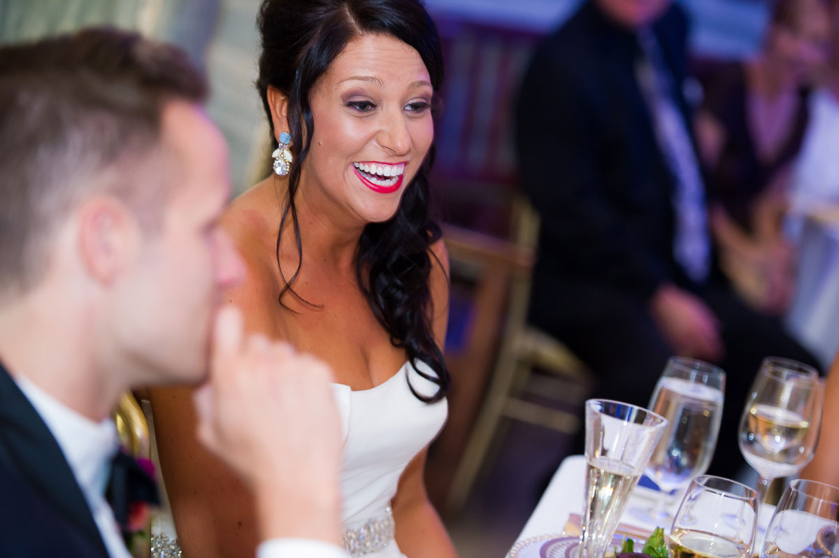 Brides laughs out loud during her maid-of-honor's toast at the Shedd Aquarium.