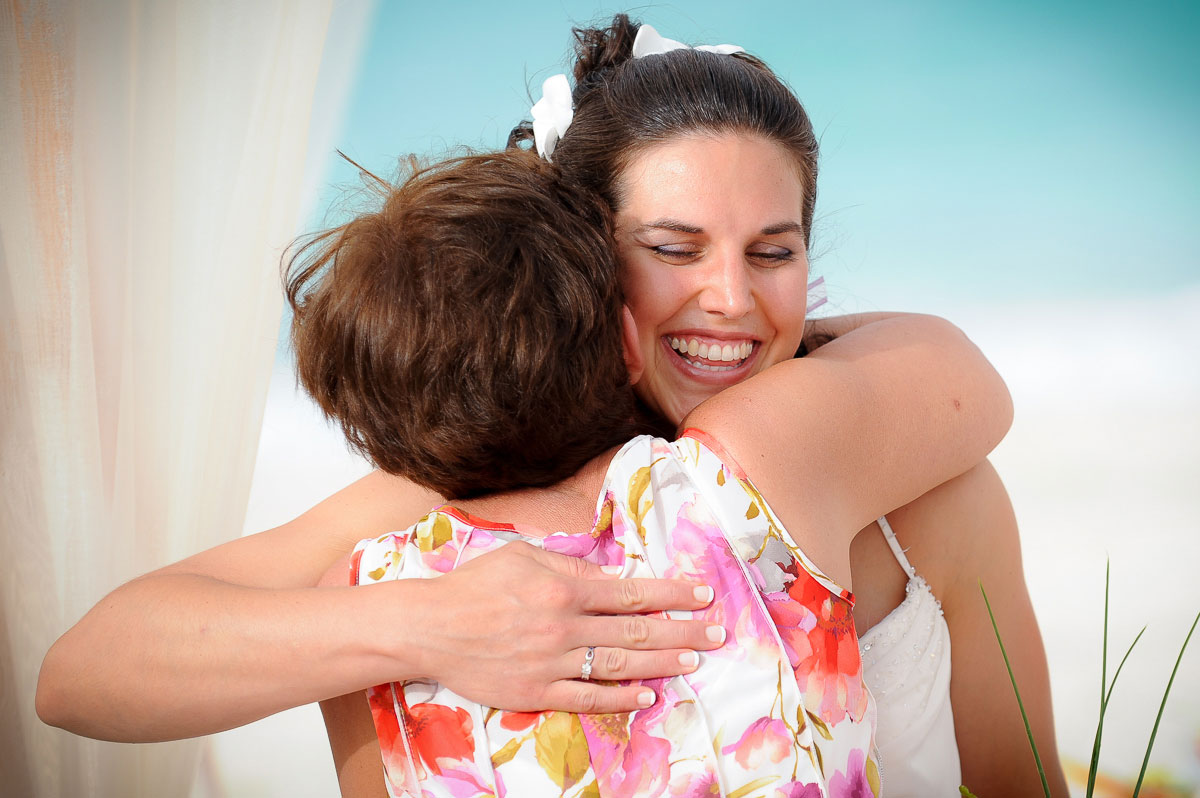 Bride hugs her aunt during her wedding ceremony at the Majestic Colonial Resort, Punta Cana, Dominican Republic.