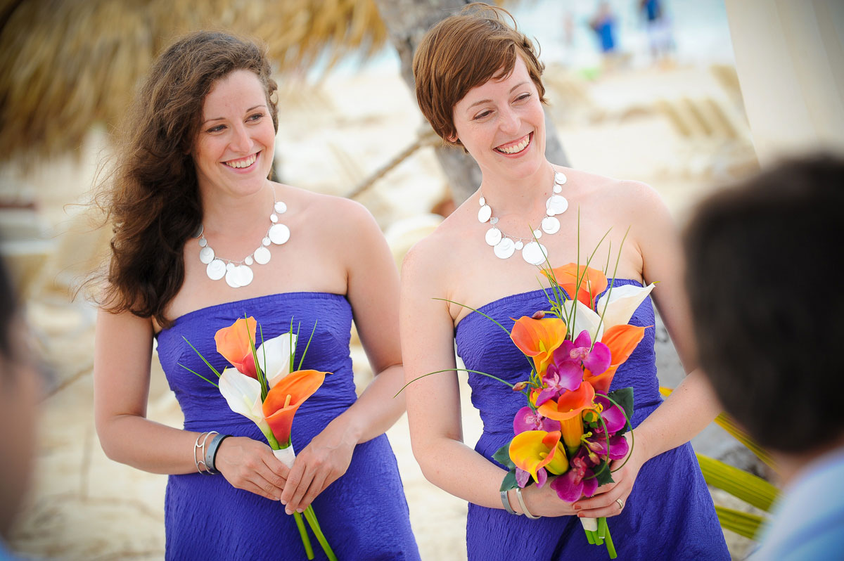 Bridesmaids laugh and smile during a wedding at the Majestic Colonial Resort, Punta Cana.