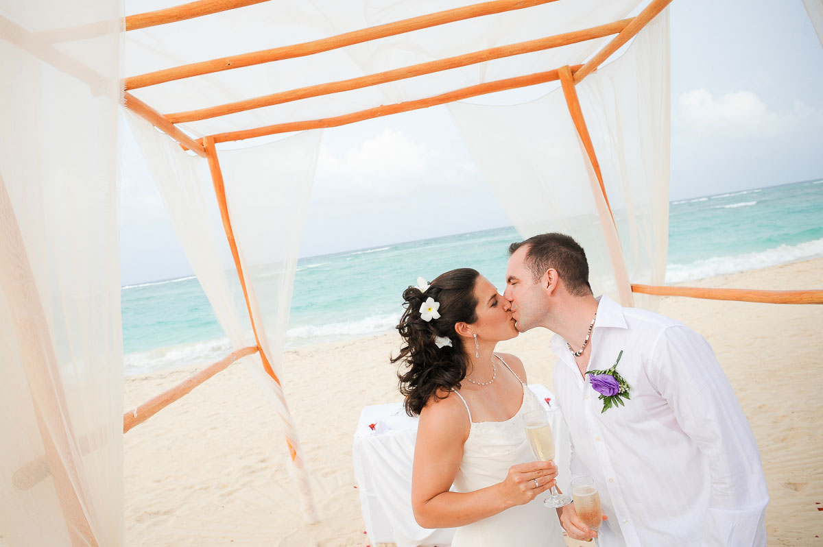 Bride & groom kiss after saying I do at the Majestic Colonial Resort, Punta Cana.