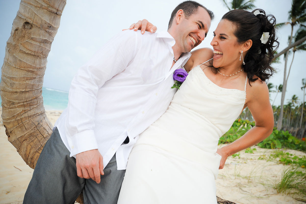 The couple goofs off during their destination wedding in Punta Cana.