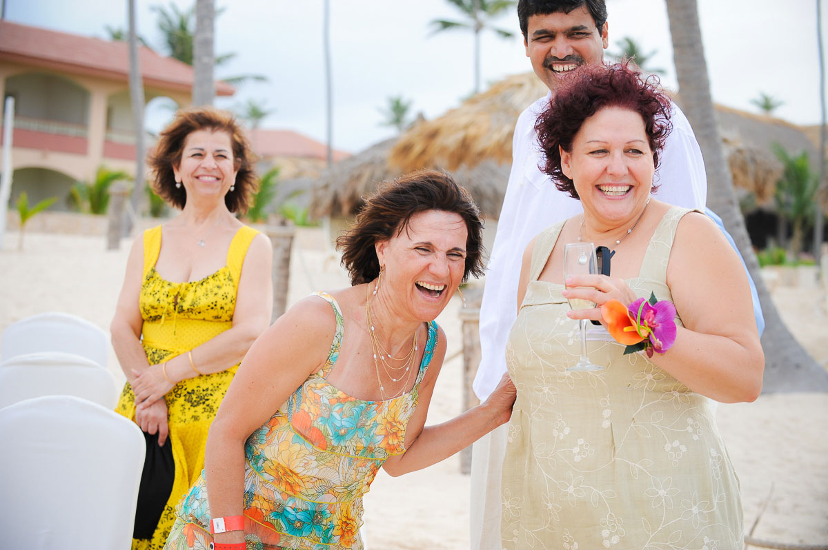 Guests share a laugh after a wedding at the Majestic Colonial Resort, Punta Cana.