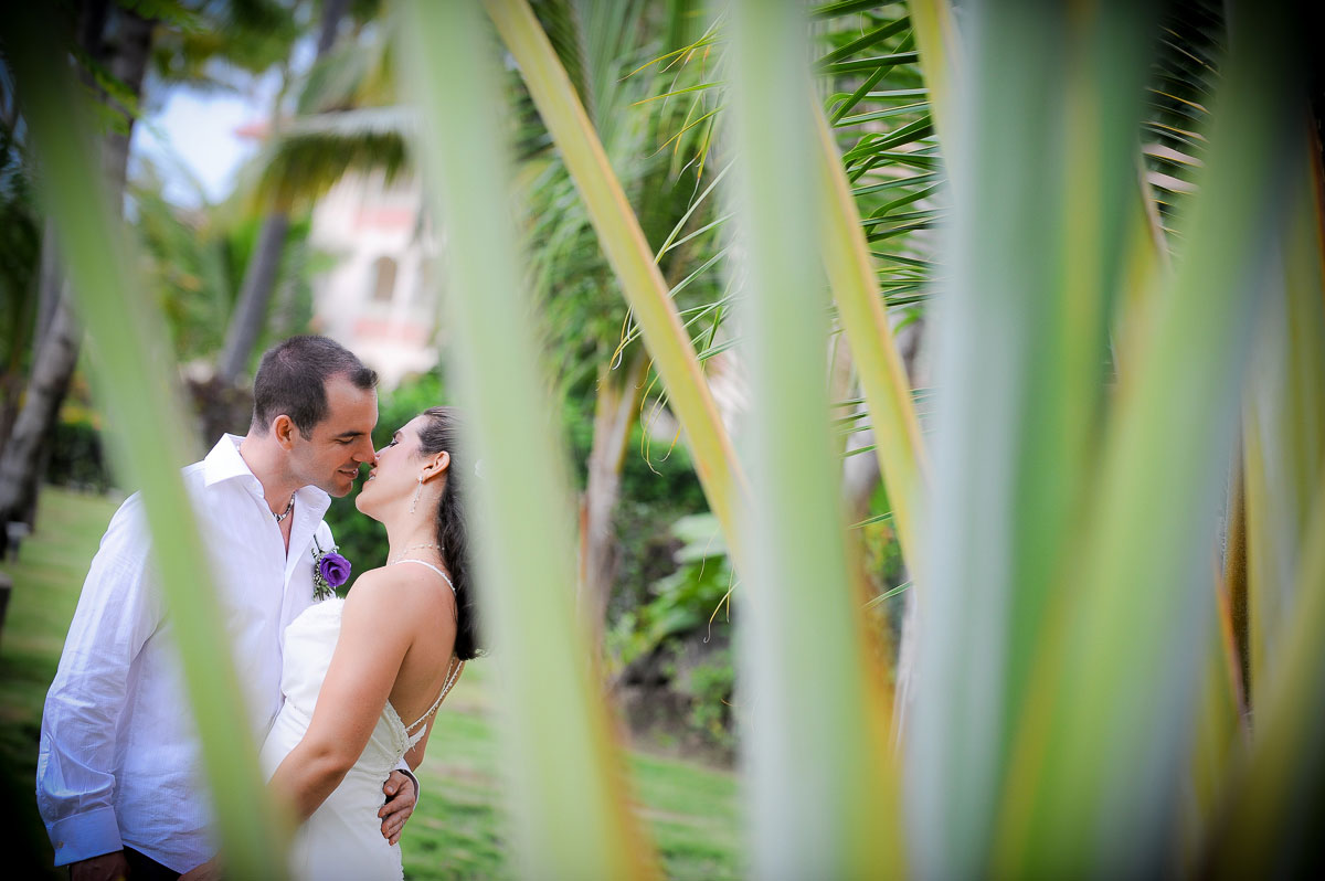 A couple's kiss during a destination wedding at the Majestic Colonial Resort, Punta Cana.