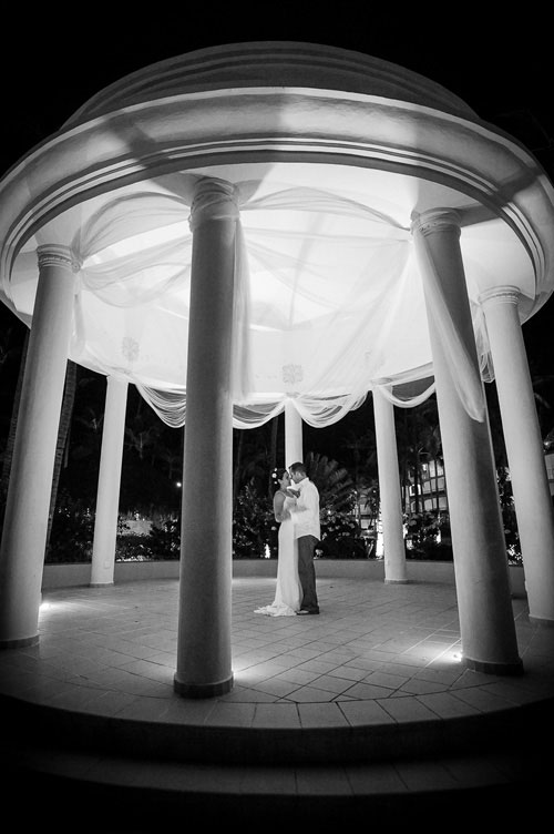 Bridge & groom slow dance under the gazebo at the Majestic Colonial Resort, Punta Cana, Dominican Republic.