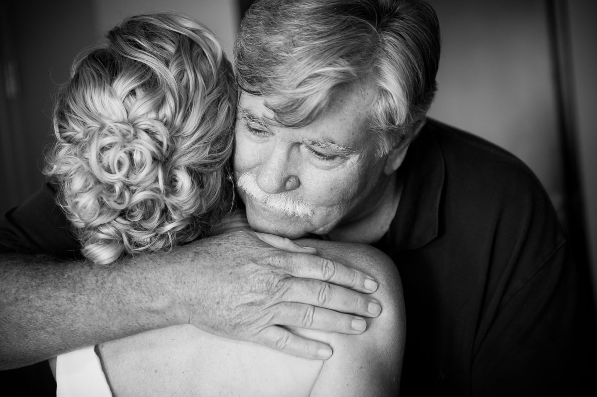 The father-of-the-bride hugs his daughter before her wedding at the Thompson Chicago Hotel.