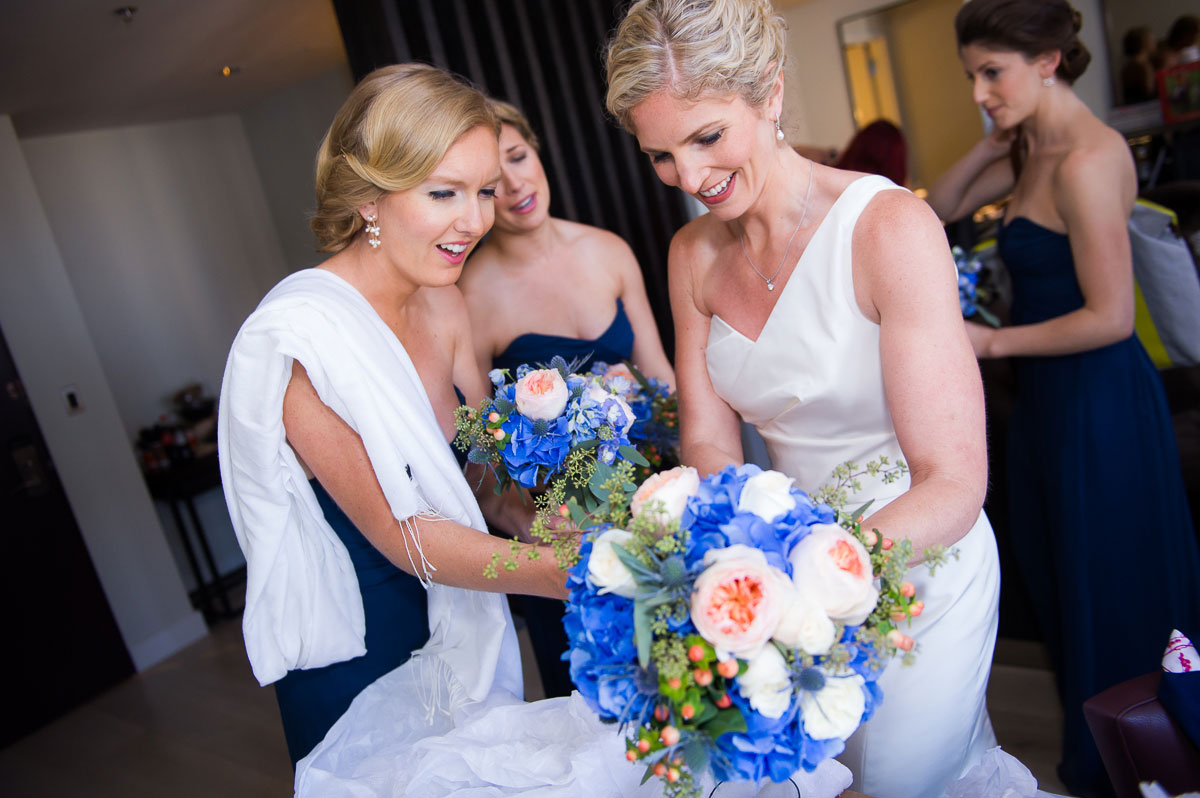 Bride receives her bouquet on her wedding day at the Thompson Chicago Hotel.