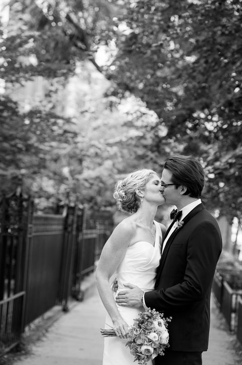 Couple embraces on their wedding day in Chicago's Gold Coast.