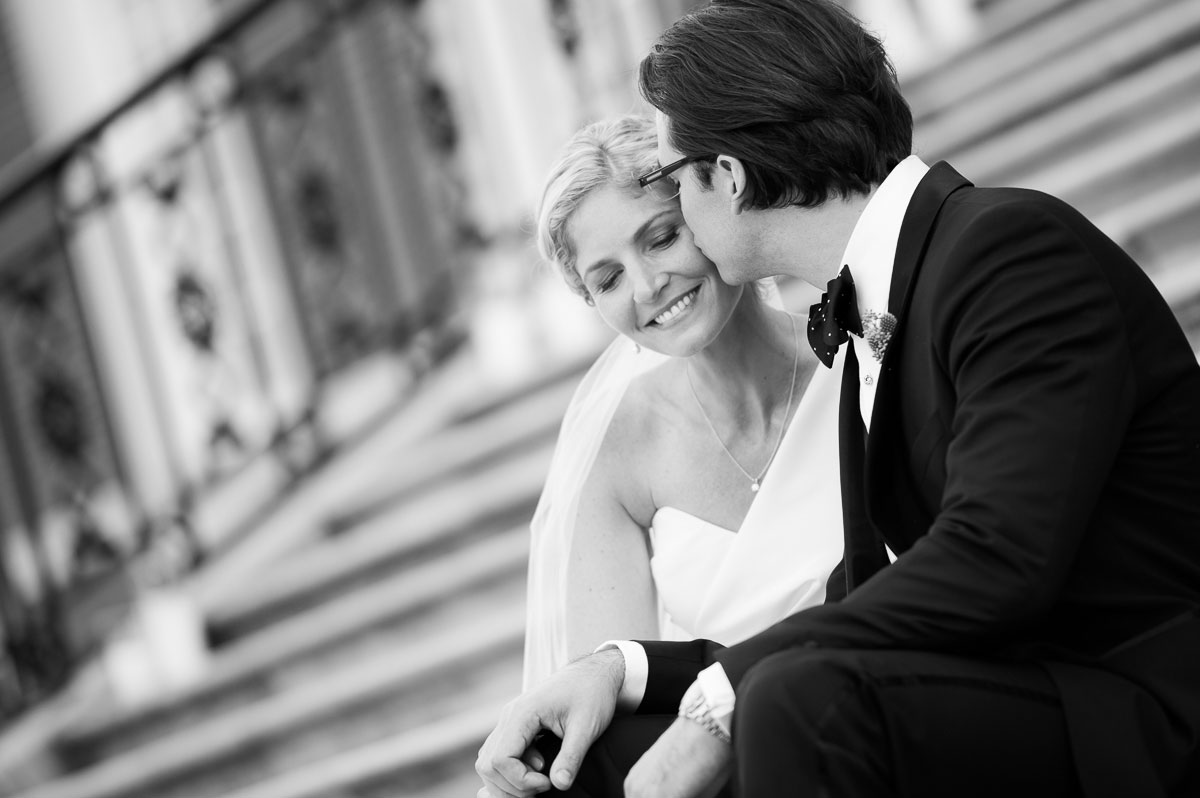 Bride & groom share a tender moment on the steps of the Chicago History Museum.