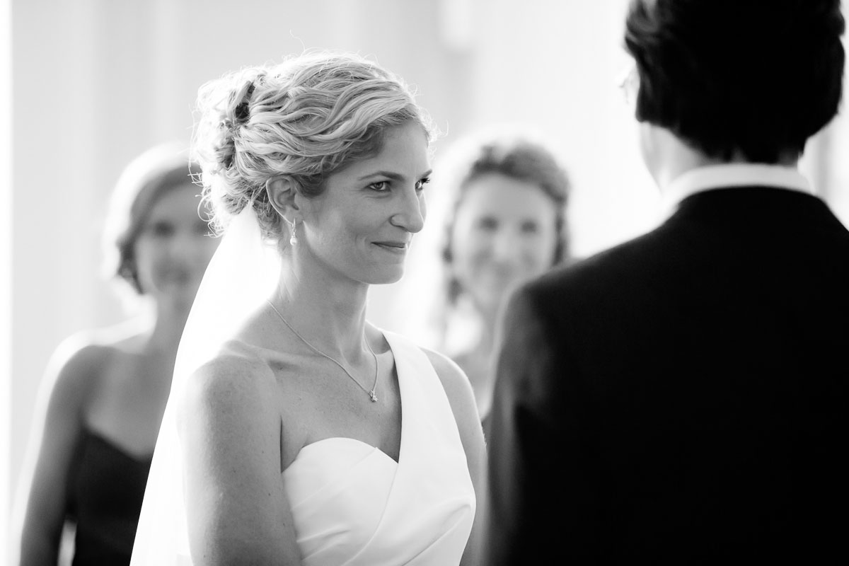 Bride gazes into her groom's eyes during their wedding ceremony at the Chicago History Museum.
