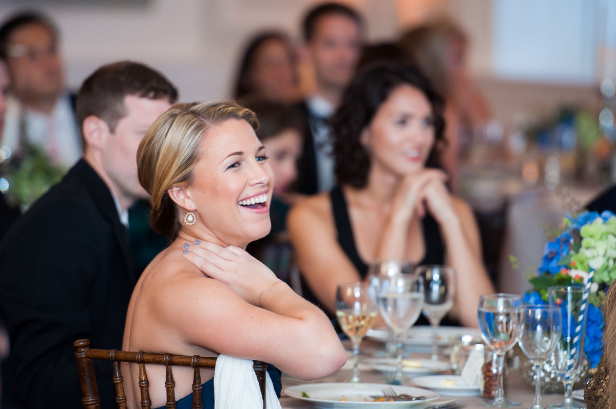 Guests share a laugh during the speeches at a wedding reception at the Chicago History Museum.