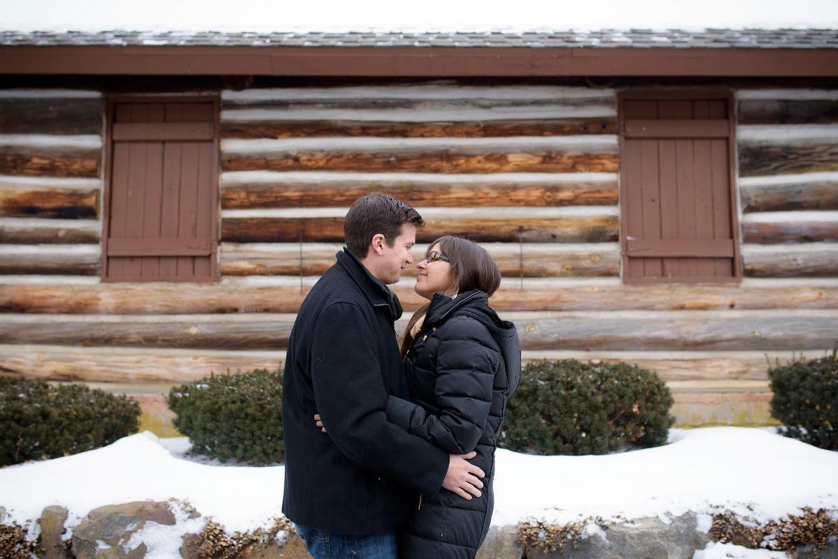 The couple embraces during their winter engagement session at Deicke Park in Huntley.