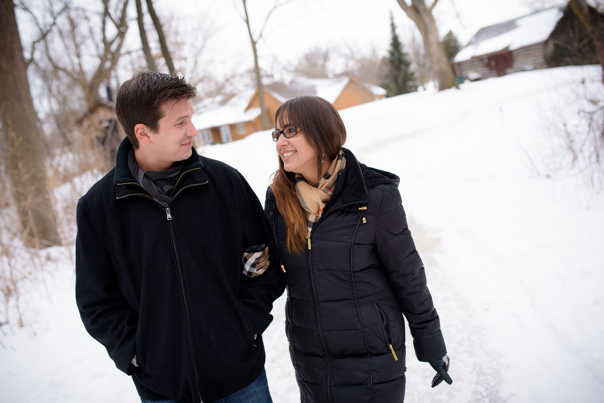 Bride & groom stroll through a snow covered Deicke Park during their winter engagement session.