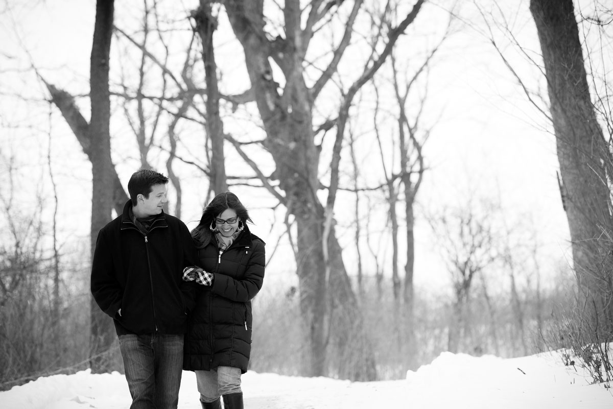 Couple takes a casual winter-time walk through Deicke Park during their engagement session.